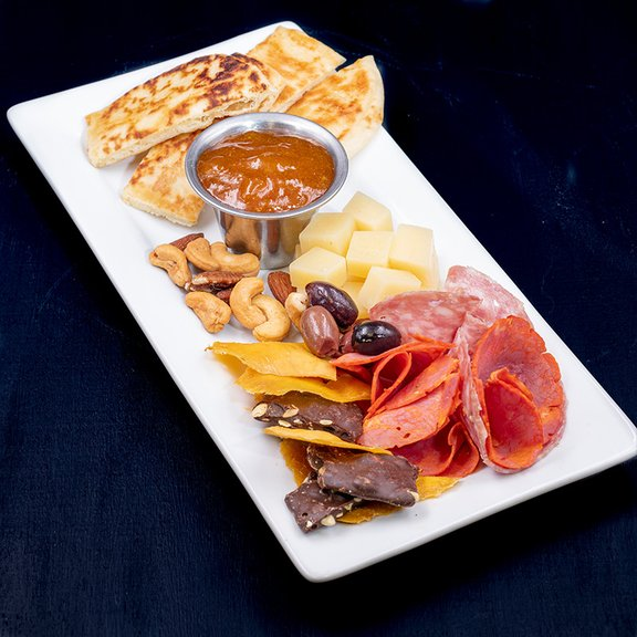 Platter with meat, cheese and pita