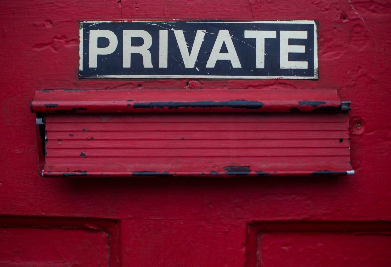 the word private on a sticker on a red door