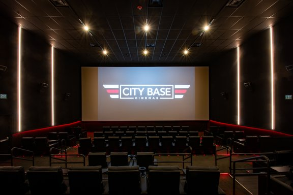 Auditorium with logo on screen
