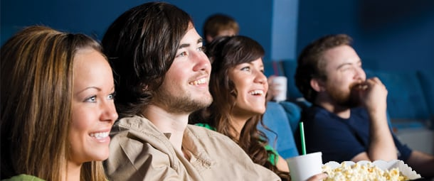 moviegoers watching a film together